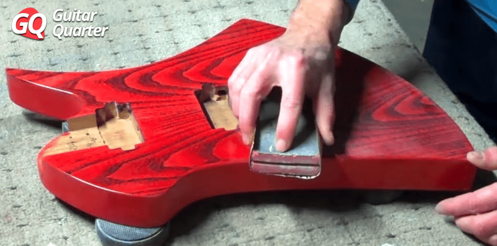 Dry sanding nitrocellulose finish for electric guitar.