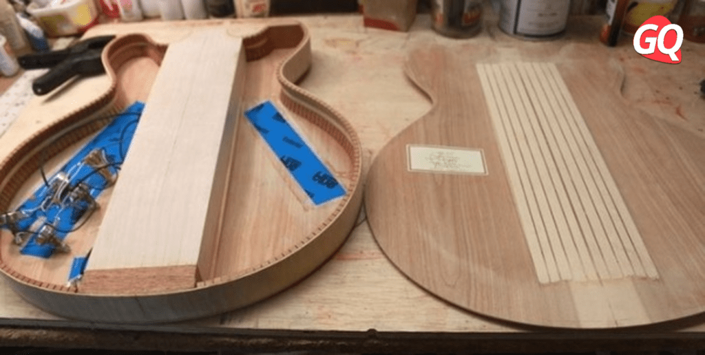 Eine Semi-Hollow- oder Semi-Hollow-Gitarre hat im Allgemeinen einen Holzblock, der durch den Korpus unter den Tonabnehmern und dem Steg verläuft.